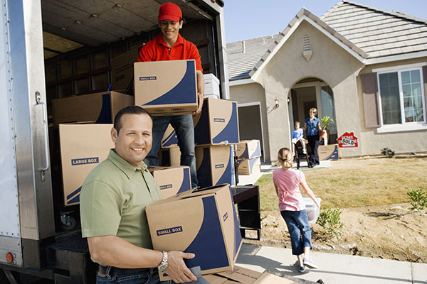 Family with the moving service worker unloads boxes for new house